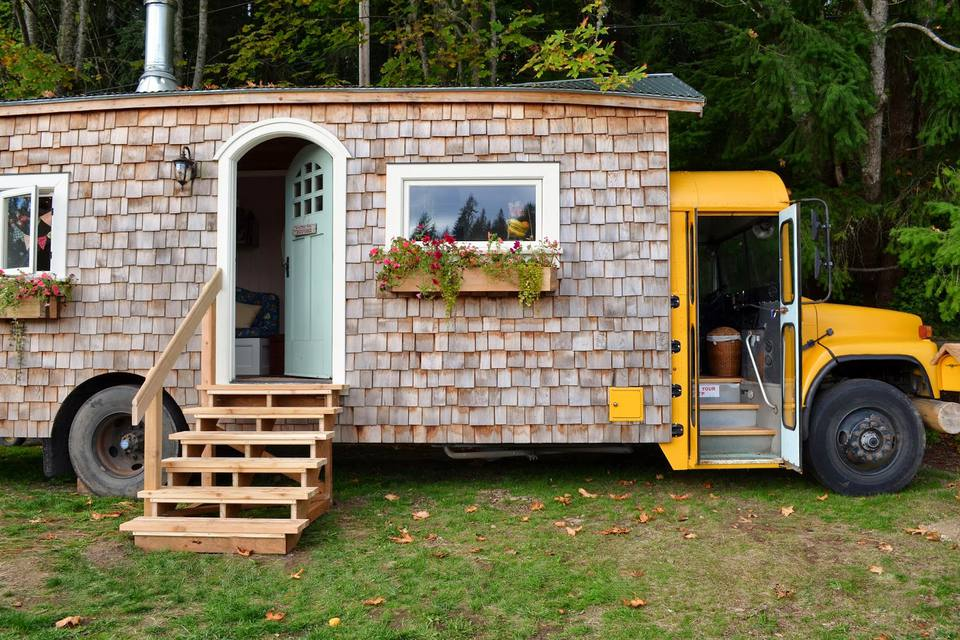 A dreamy cottage styled skoolie built by Jeremy and Mira Thompson