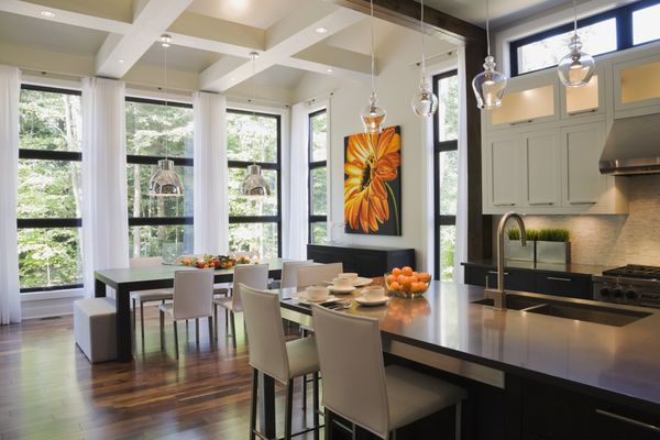 Upscale Kitchen with High Open Ceiling and Wood Floor