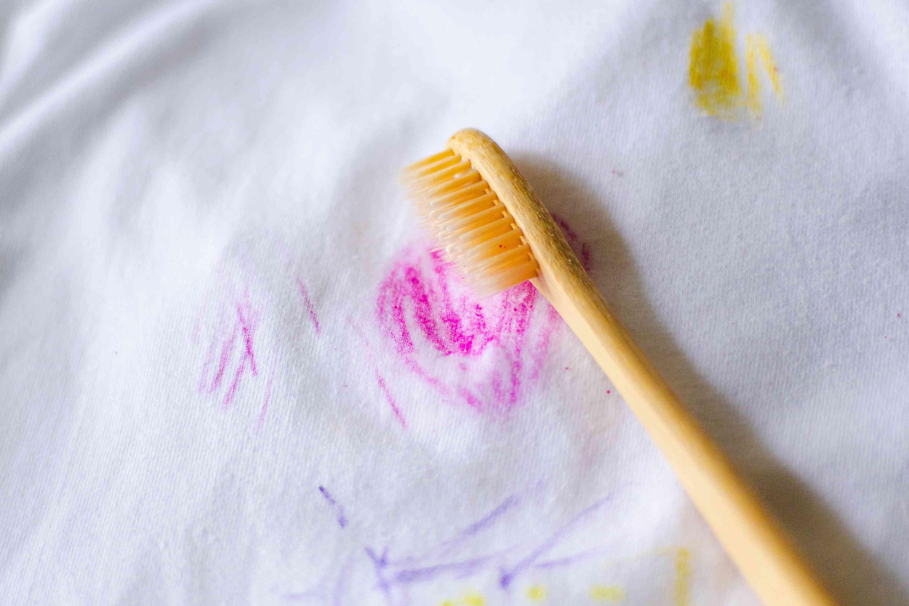 treating the stain with detergent