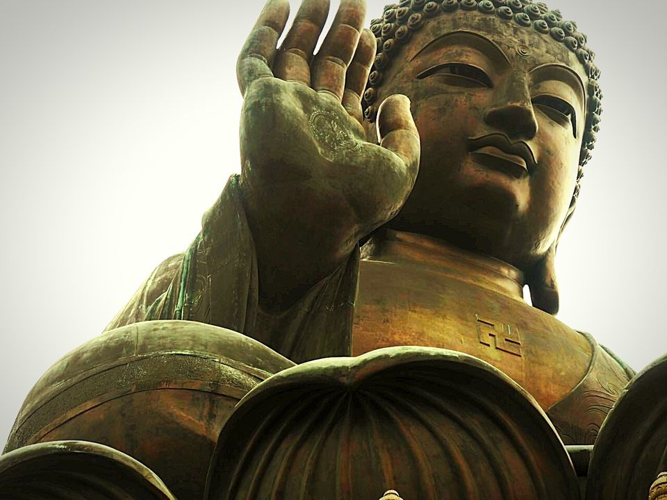 Low Angle View Of Giant Buddha Statue At Tian Tan Buddha