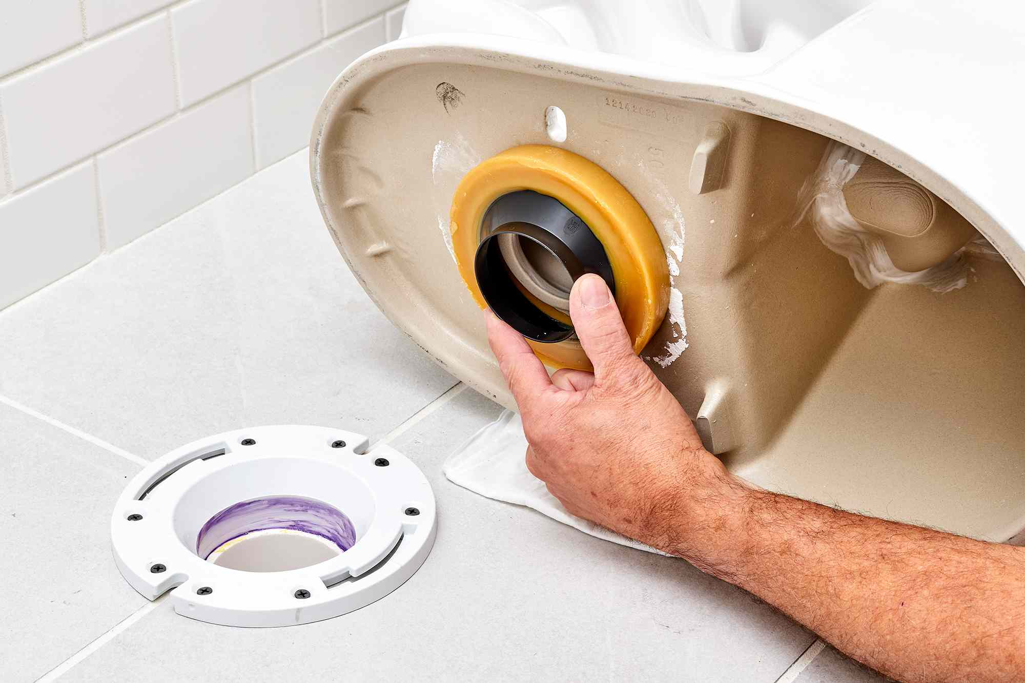 New wax ring applied to bottom of clean toilet