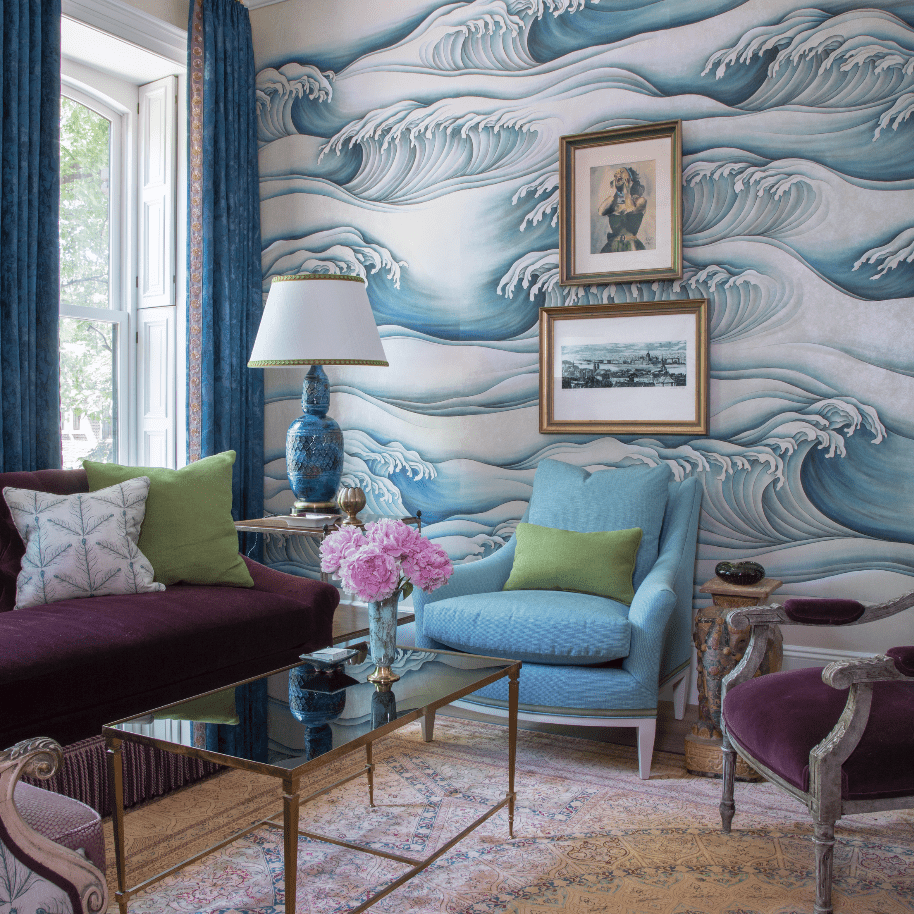 Living room with ocean waves on the wall
