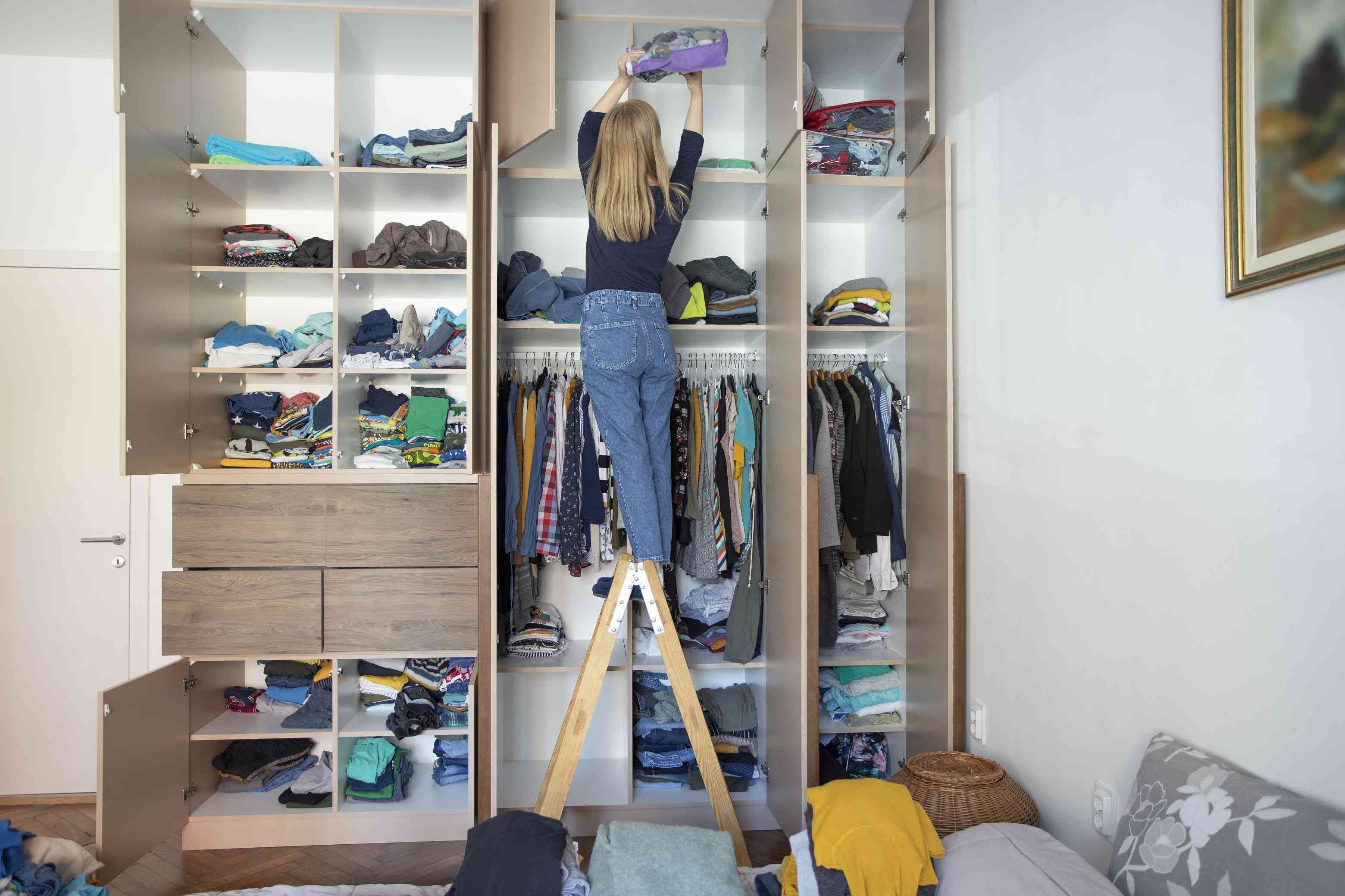 Woman cleaning her home and folding clothes