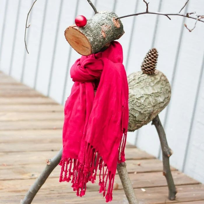 A reindeer made of logs and sticks