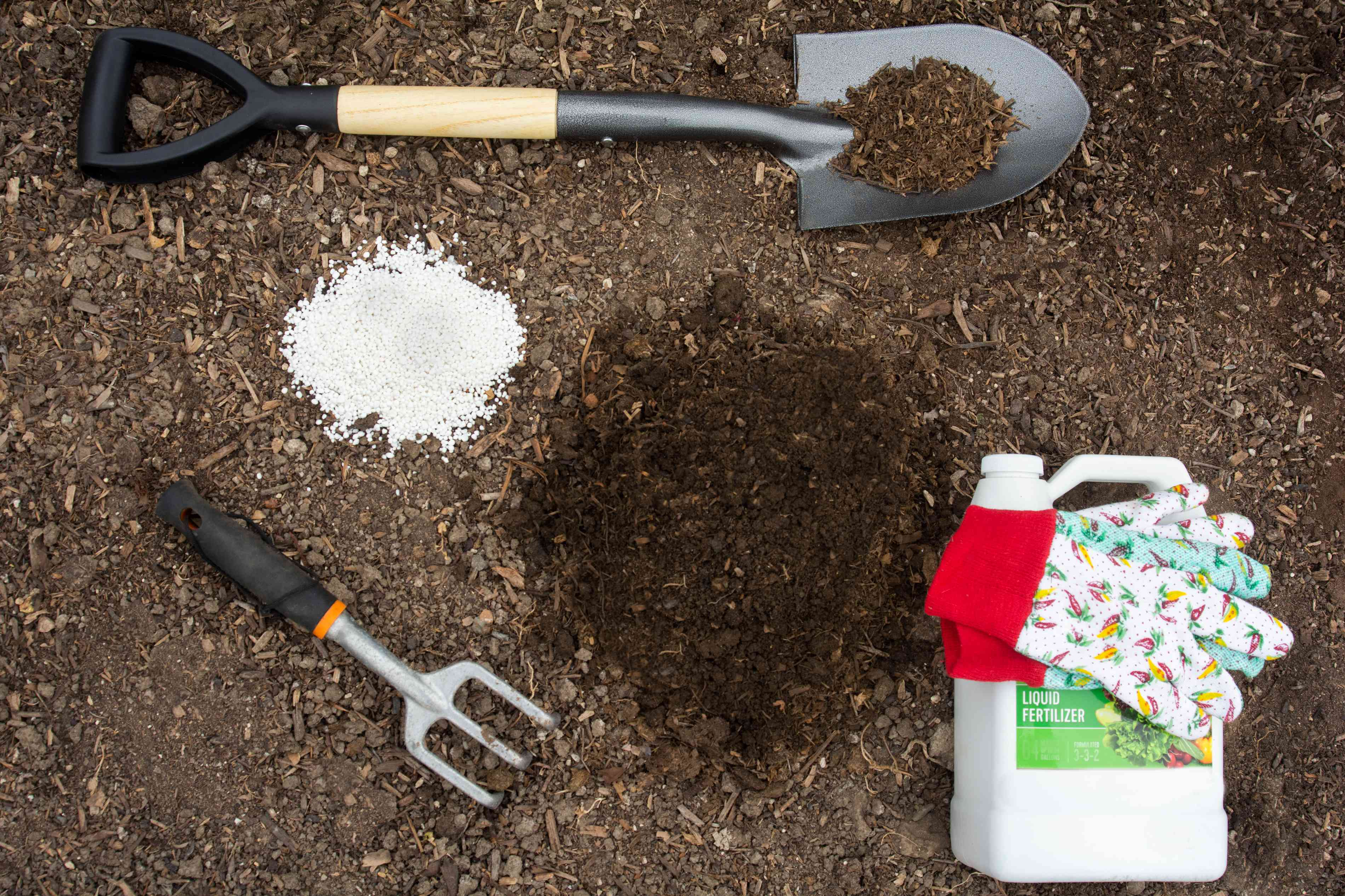 Materials and tools to improve garden soil with amendments