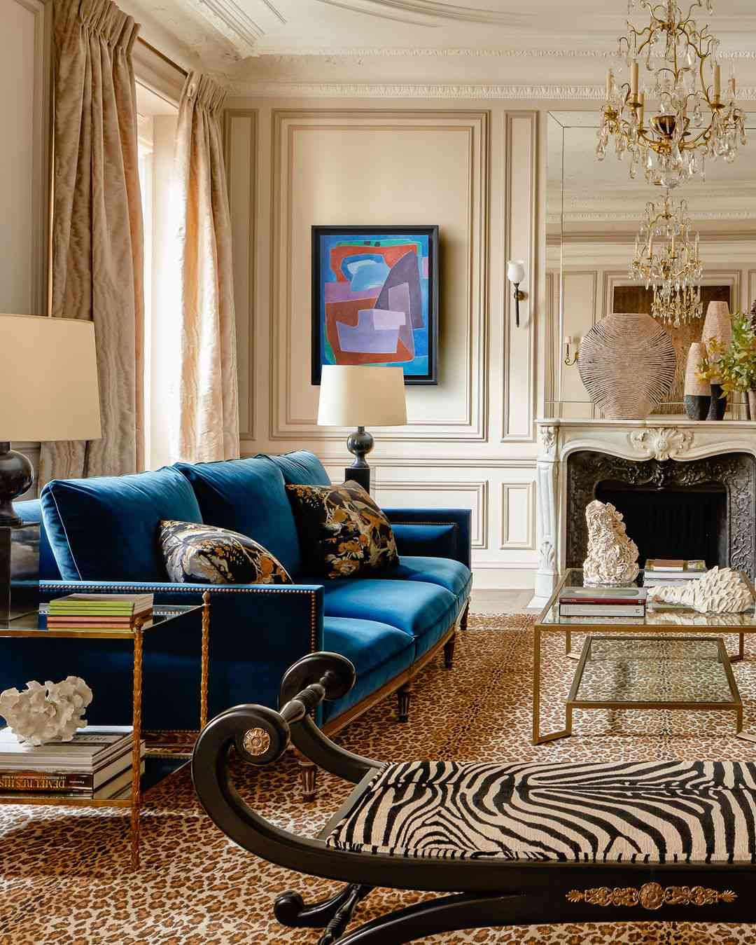 Living room with zebra print and blue sofa