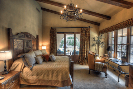 rustic wooden beams, plaster wall finishes, tuscan bedroom furniture, wrought iron chandeliers