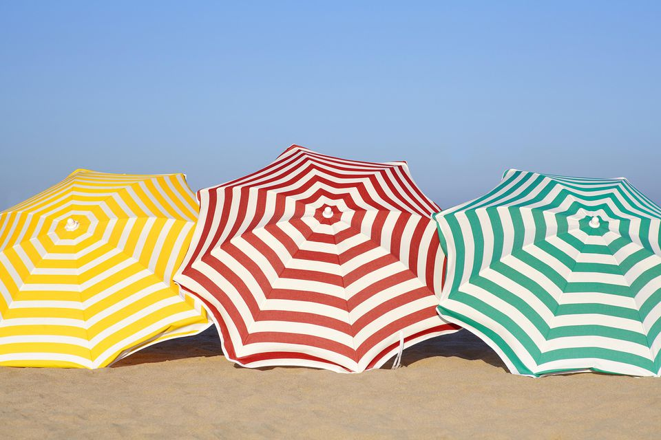 Three beach umbrellas on the sand