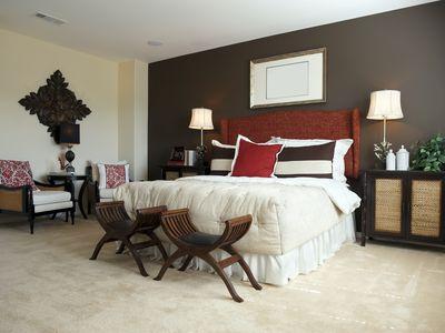 Designer bedroom with dark brown walls