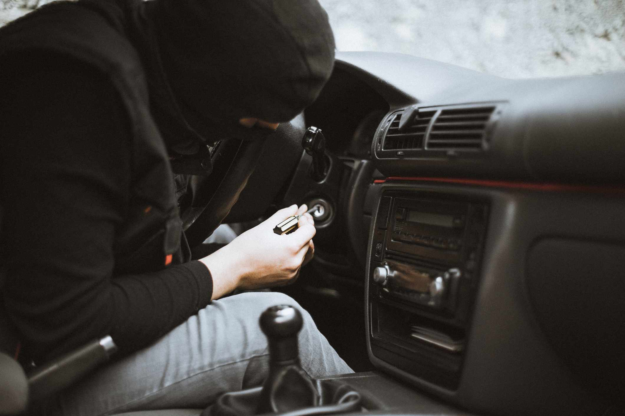 Thief trying to start up the car with a screwdriver