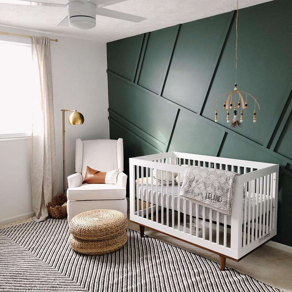 Modern Nursery with dark green paneled accent wall treatment