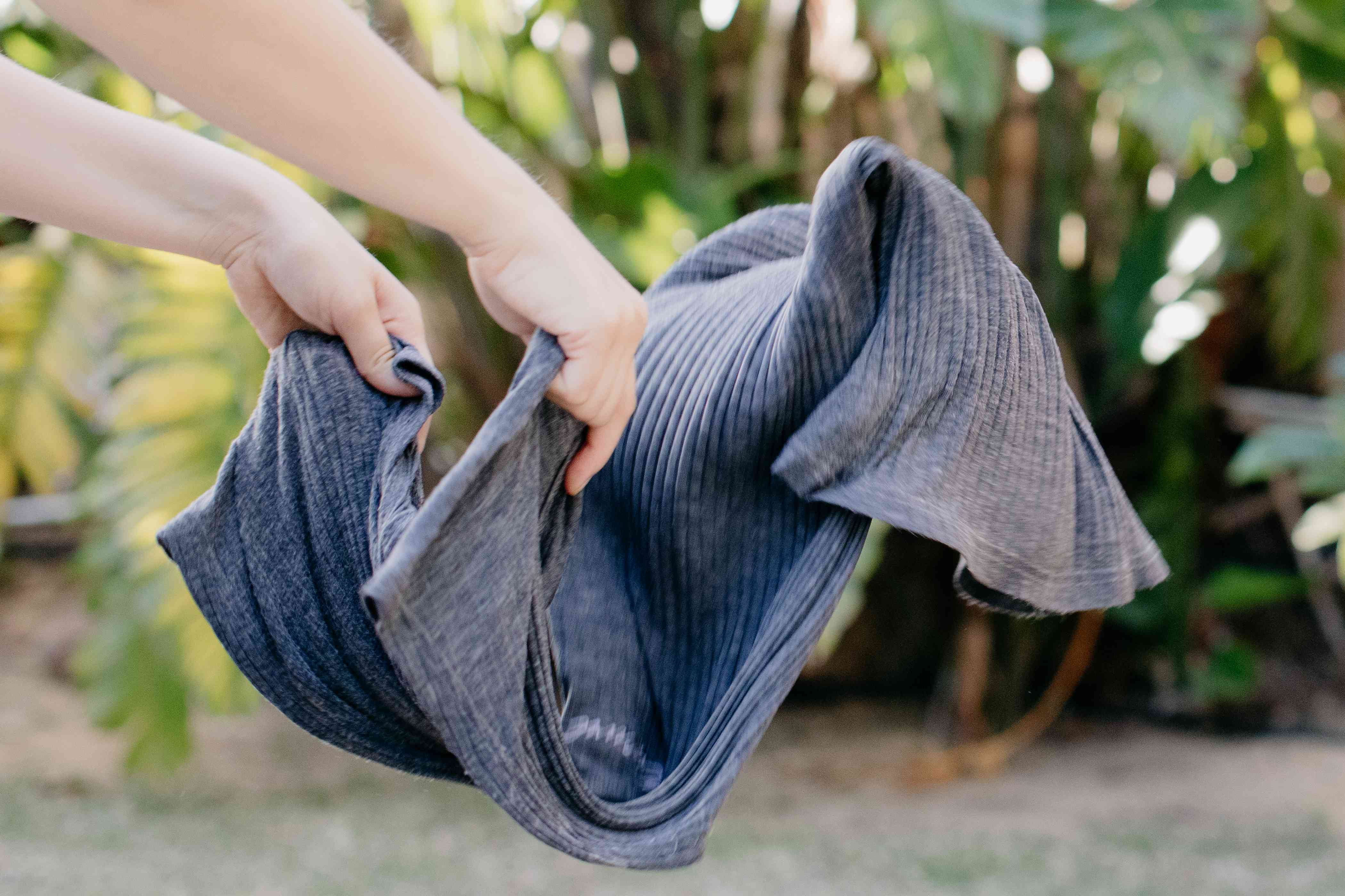 person shaking out clothes