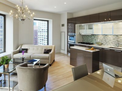 Kitchen, dining and living room in urban apartment