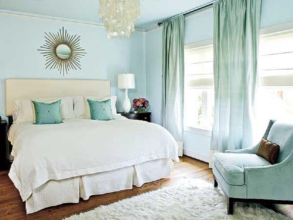 Calm light blue bedroom.