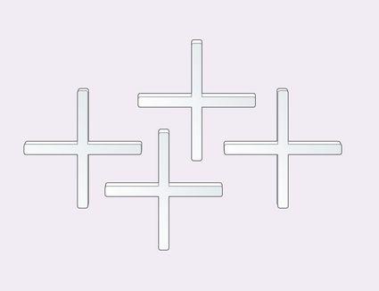 Tile spacers looking like crosses or plus signs.