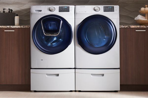 Washer and dryer pair, side-by-side in a modern laundry room