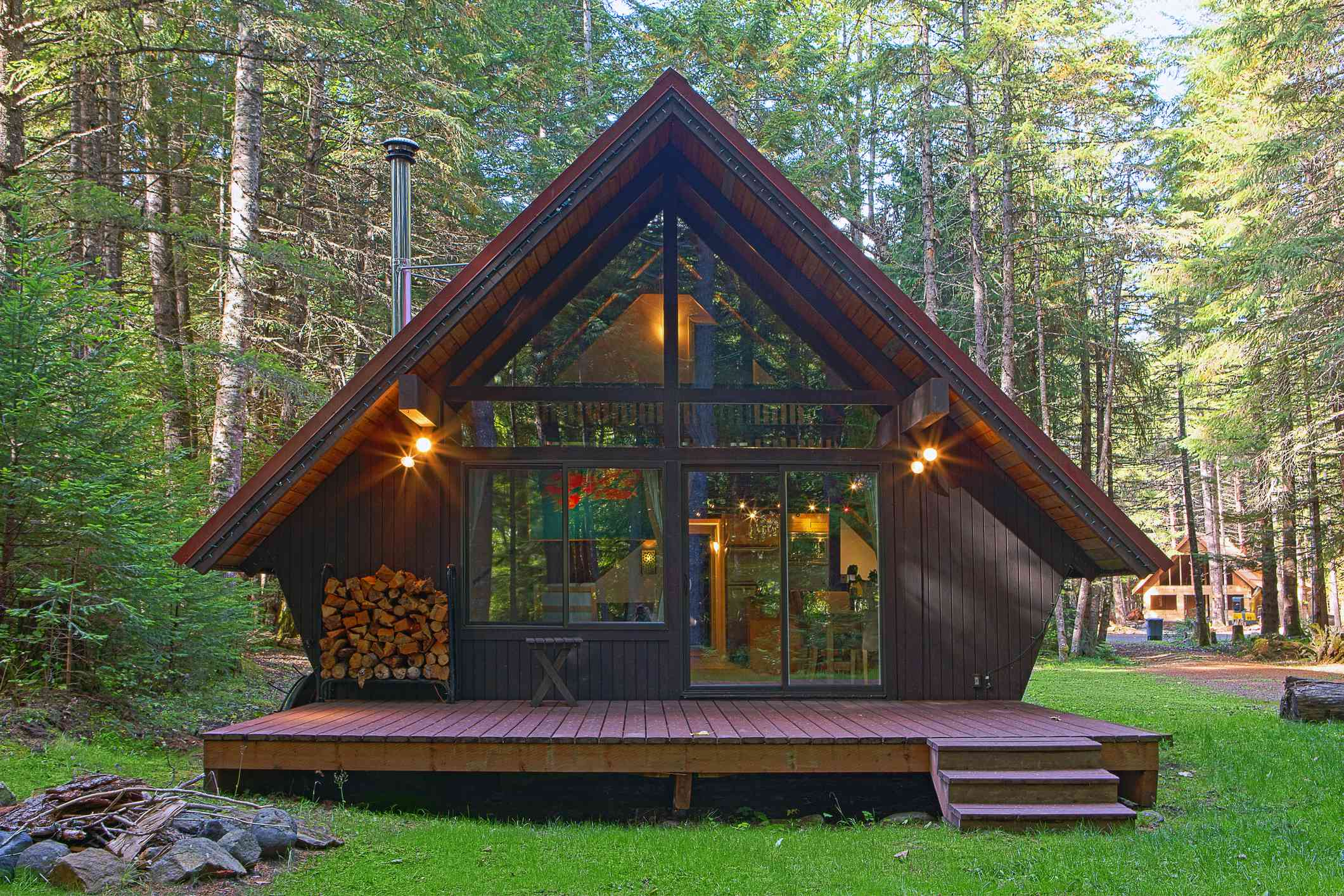 Modern cabin with backyard in forest
