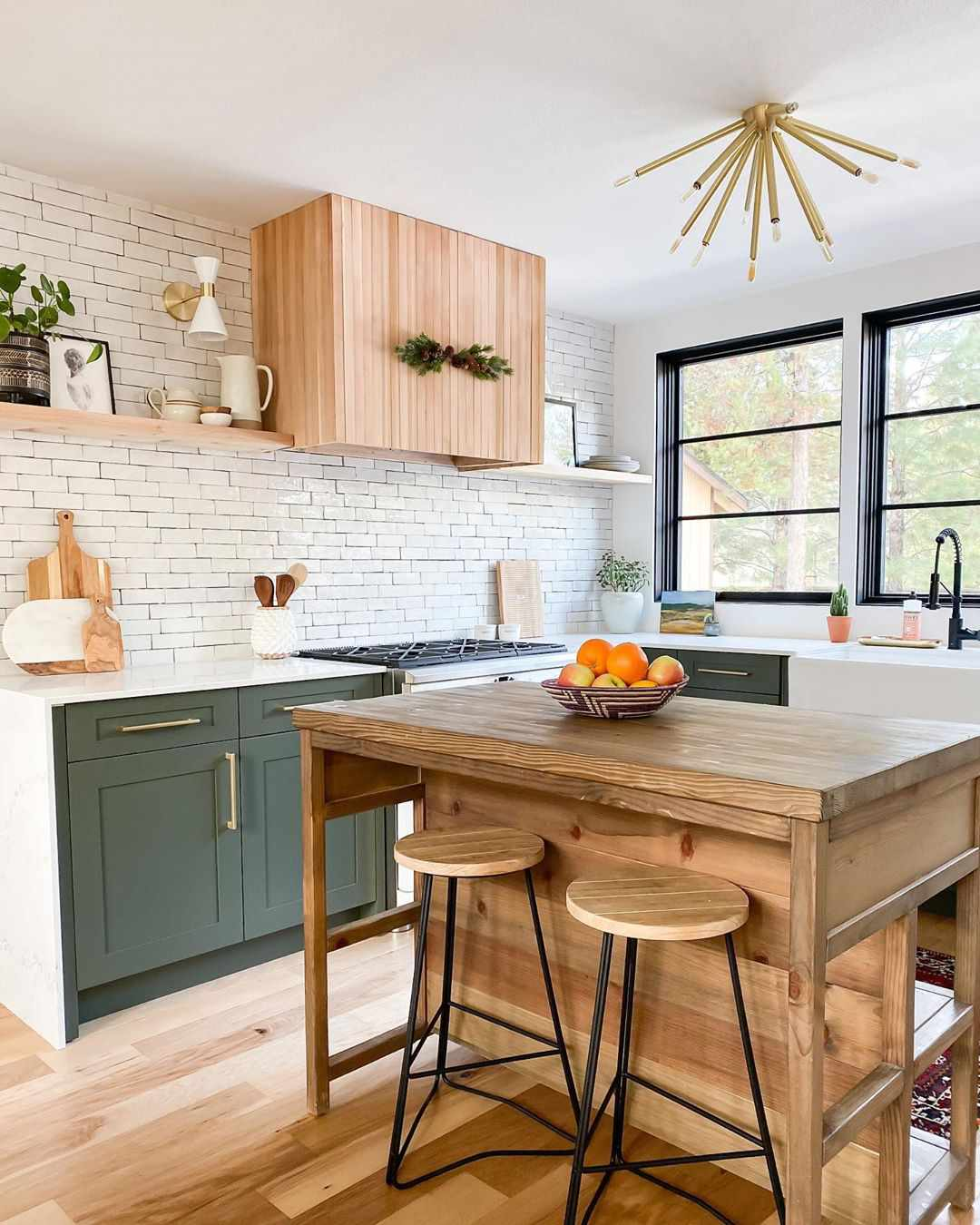 Green kitchen with wooden island