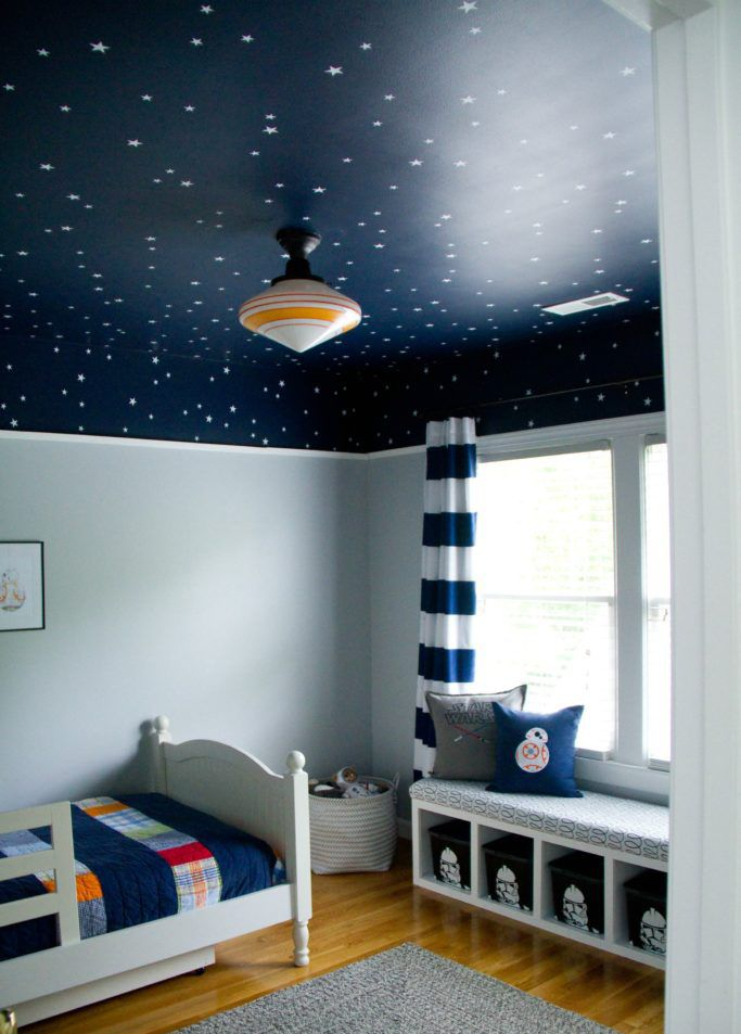 Star Wars space-themed bedroom with star ceiling mural