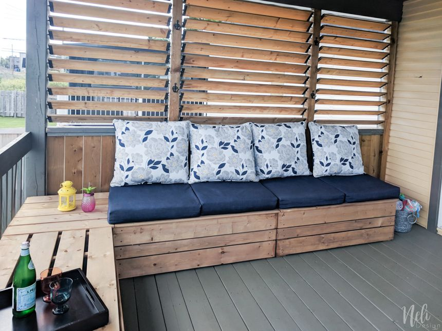 An outdoor bench on a covered porch