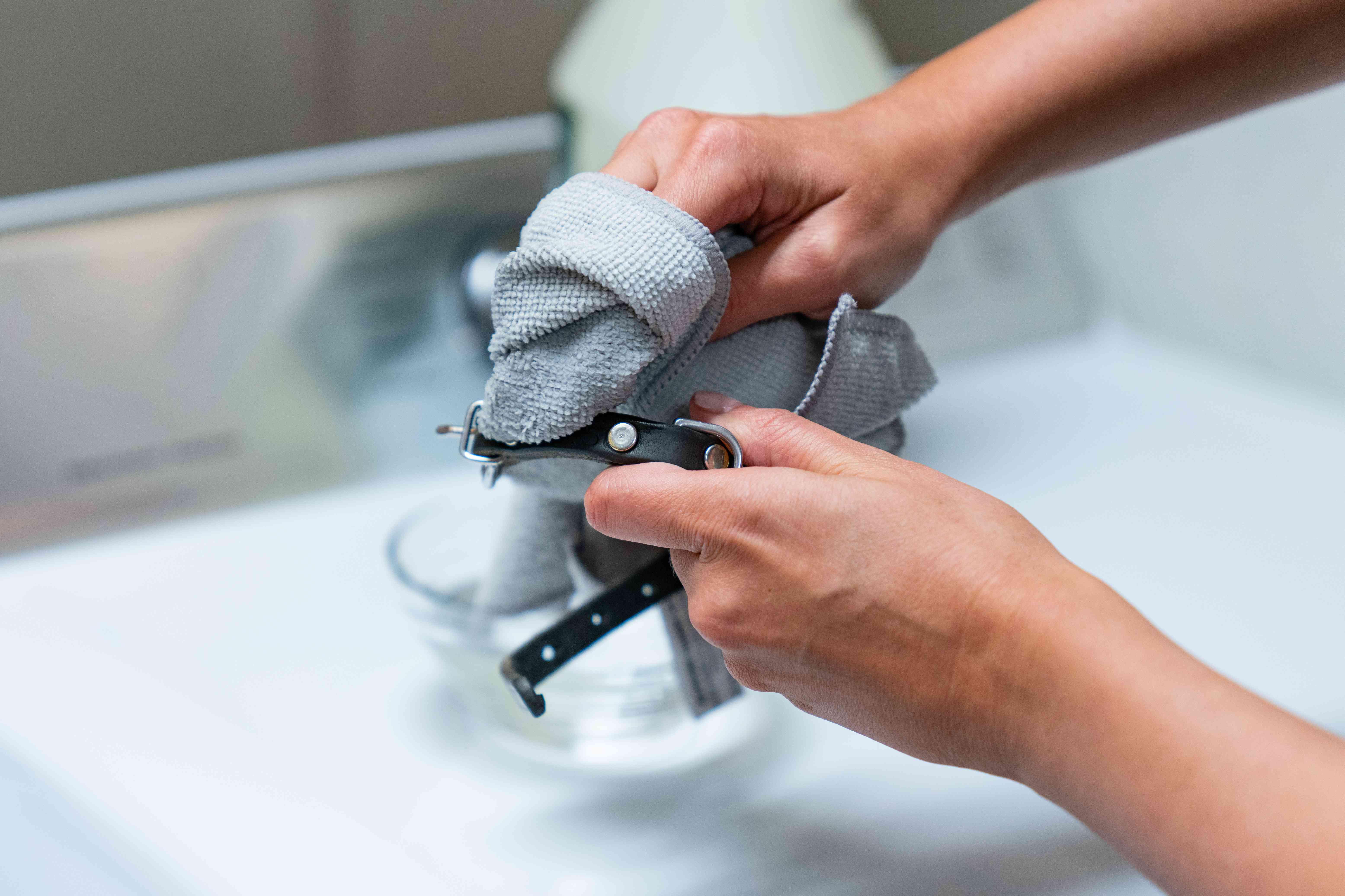 hand-cleaning a dog collar