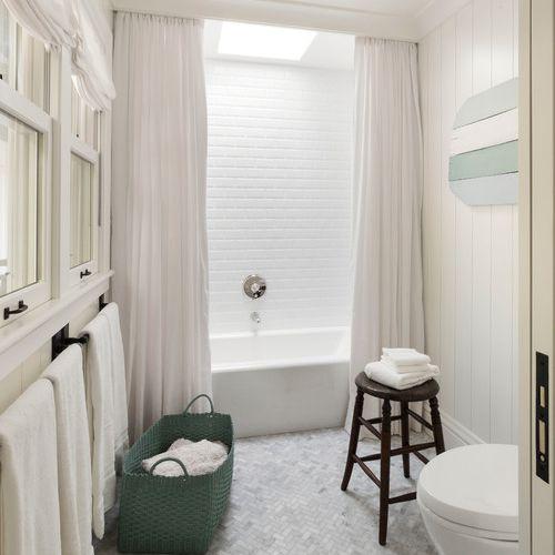 Grey herringbone bathroom floor tile