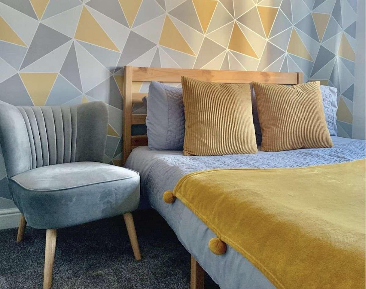 mustard yellow and gray midcentury modern bedroom