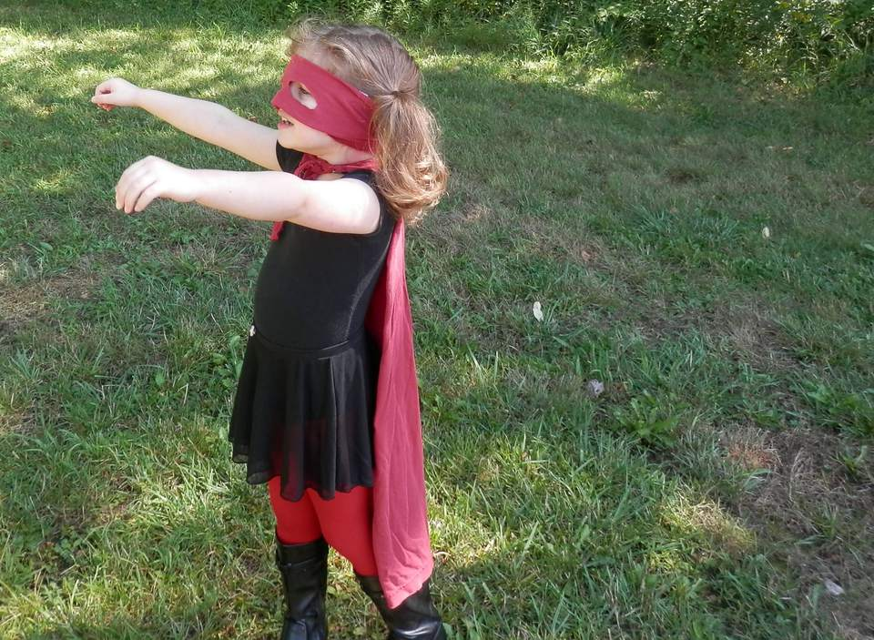 Girl dresses as superhero.