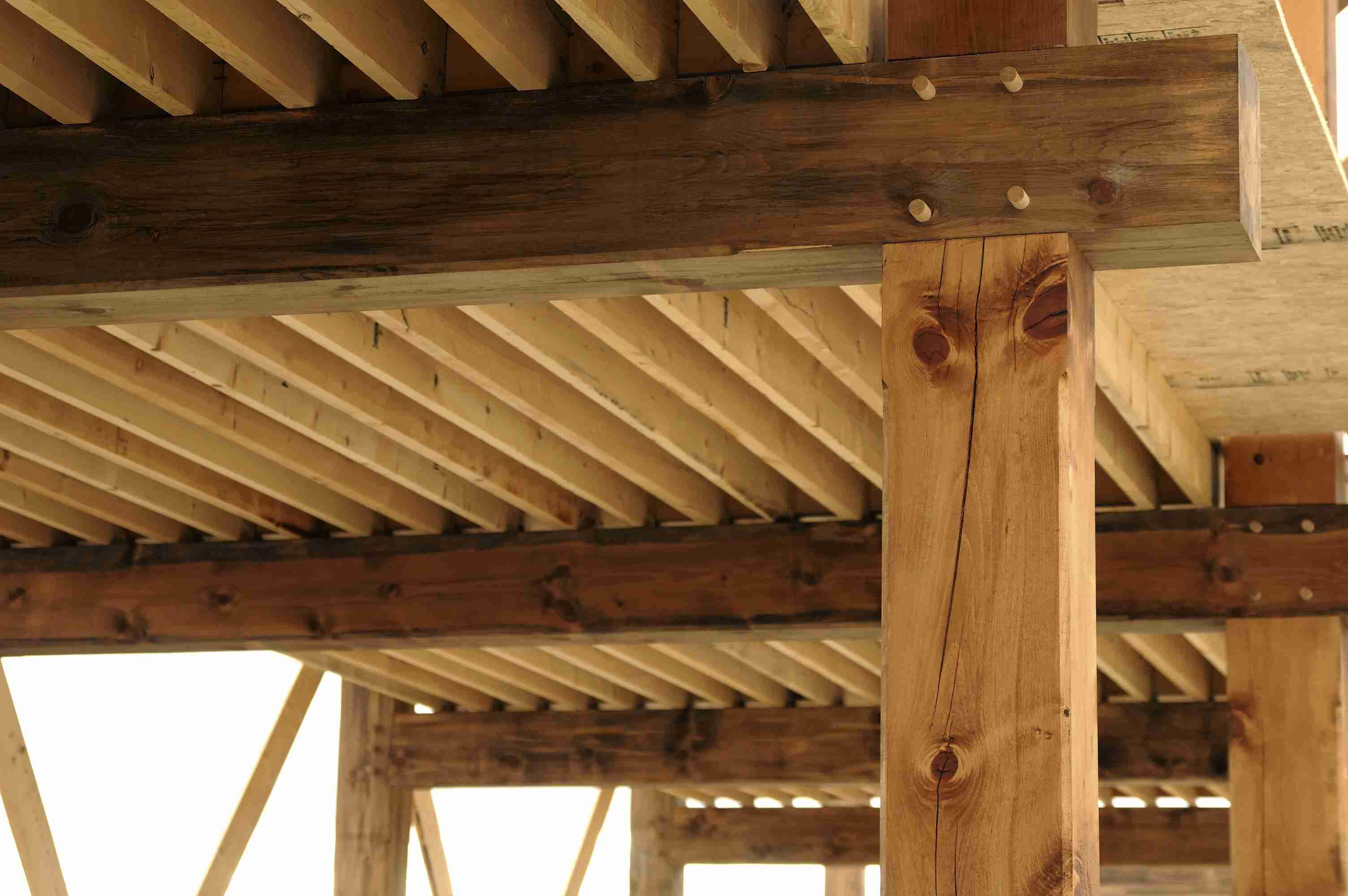 detail of timber-framed structure with large wooden beams held together with wooden pegs