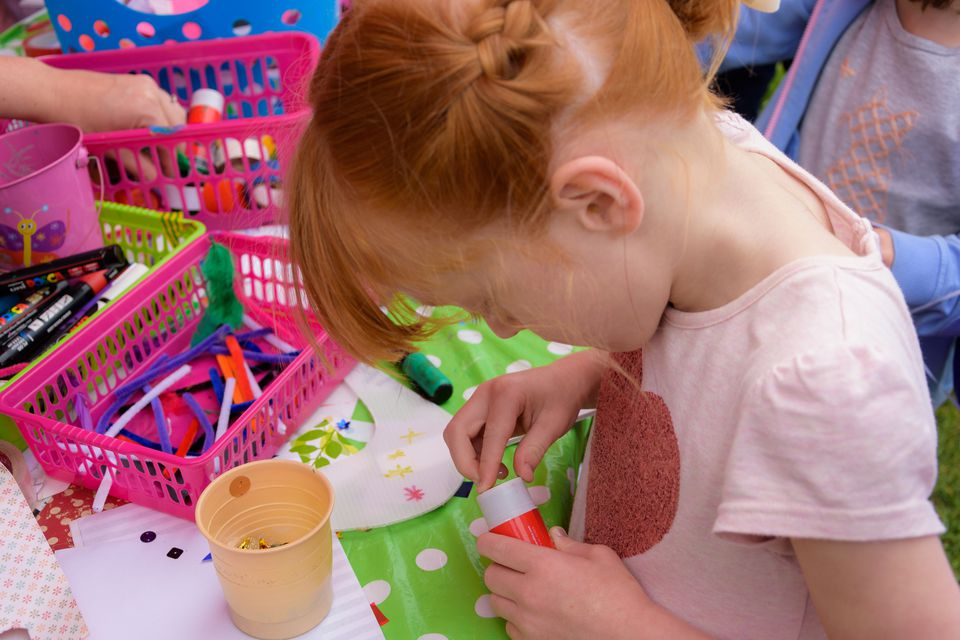 young girl crafting at party