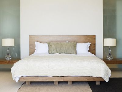 Modern double bed with bedside tables
