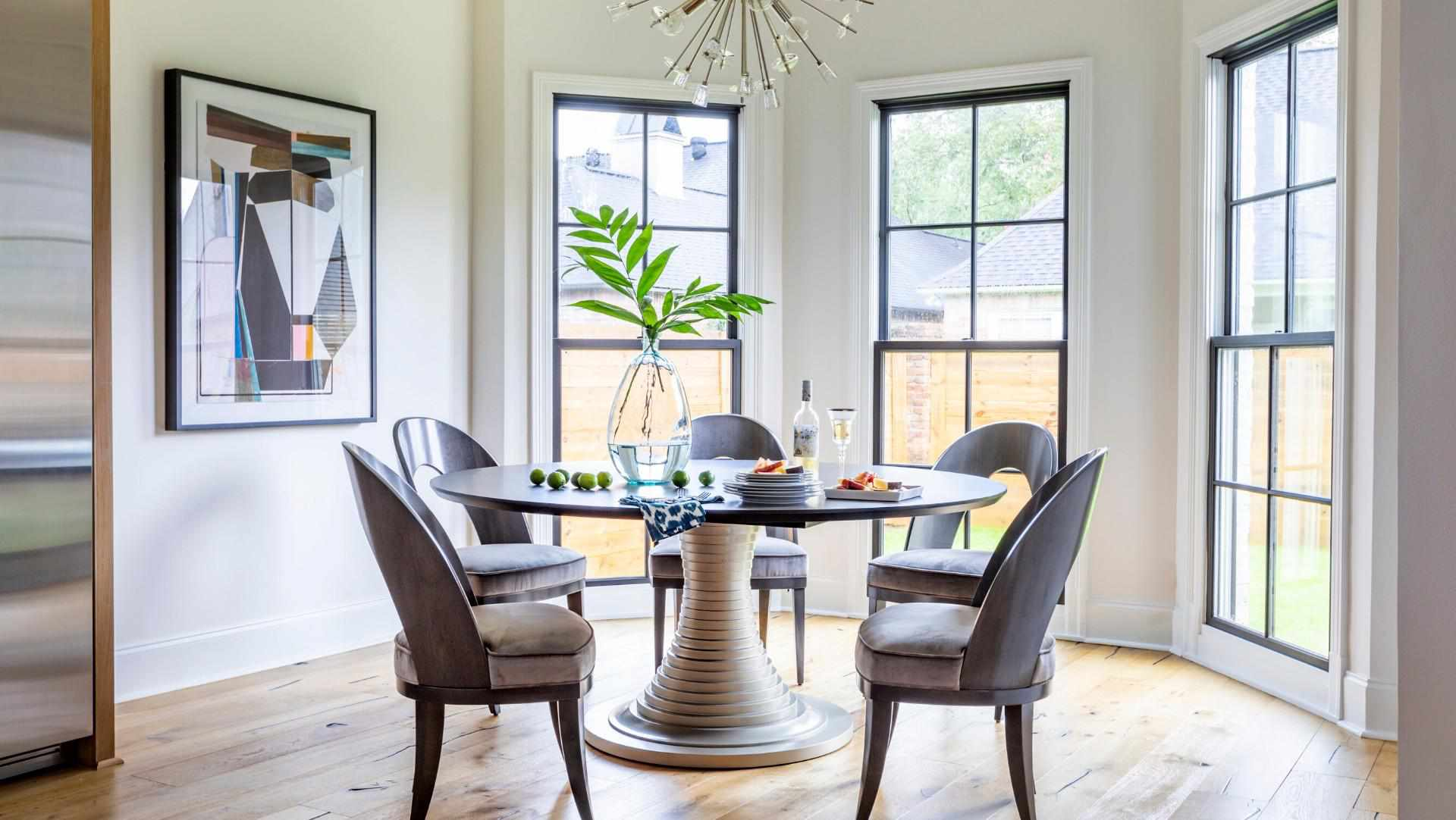 dining nook with large windows and round table