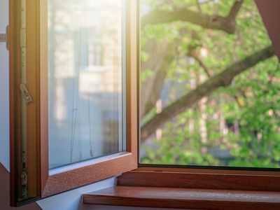 open window with wooden frame, cozy house