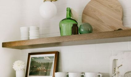 Open shelving with mugs, glassware, and picture in frame.