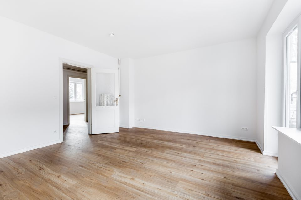 refinished hardwood floors in white painted home