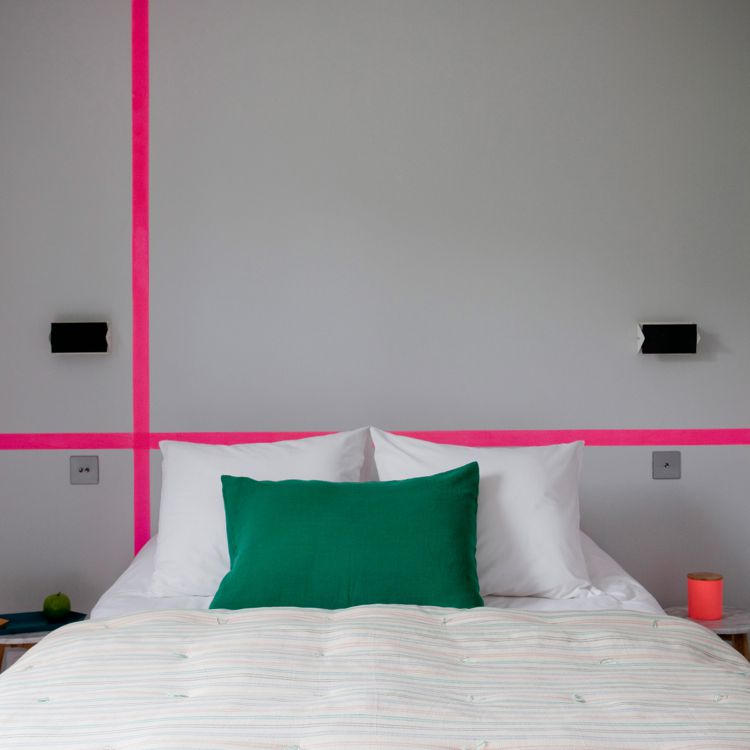 Gray bedroom with pink stripes