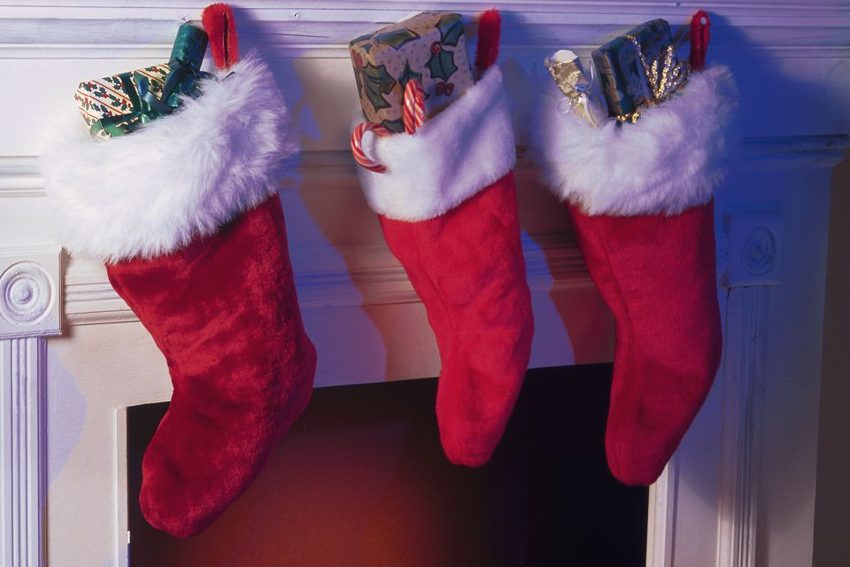 Christmas stockings hanging from fireplace mantle.