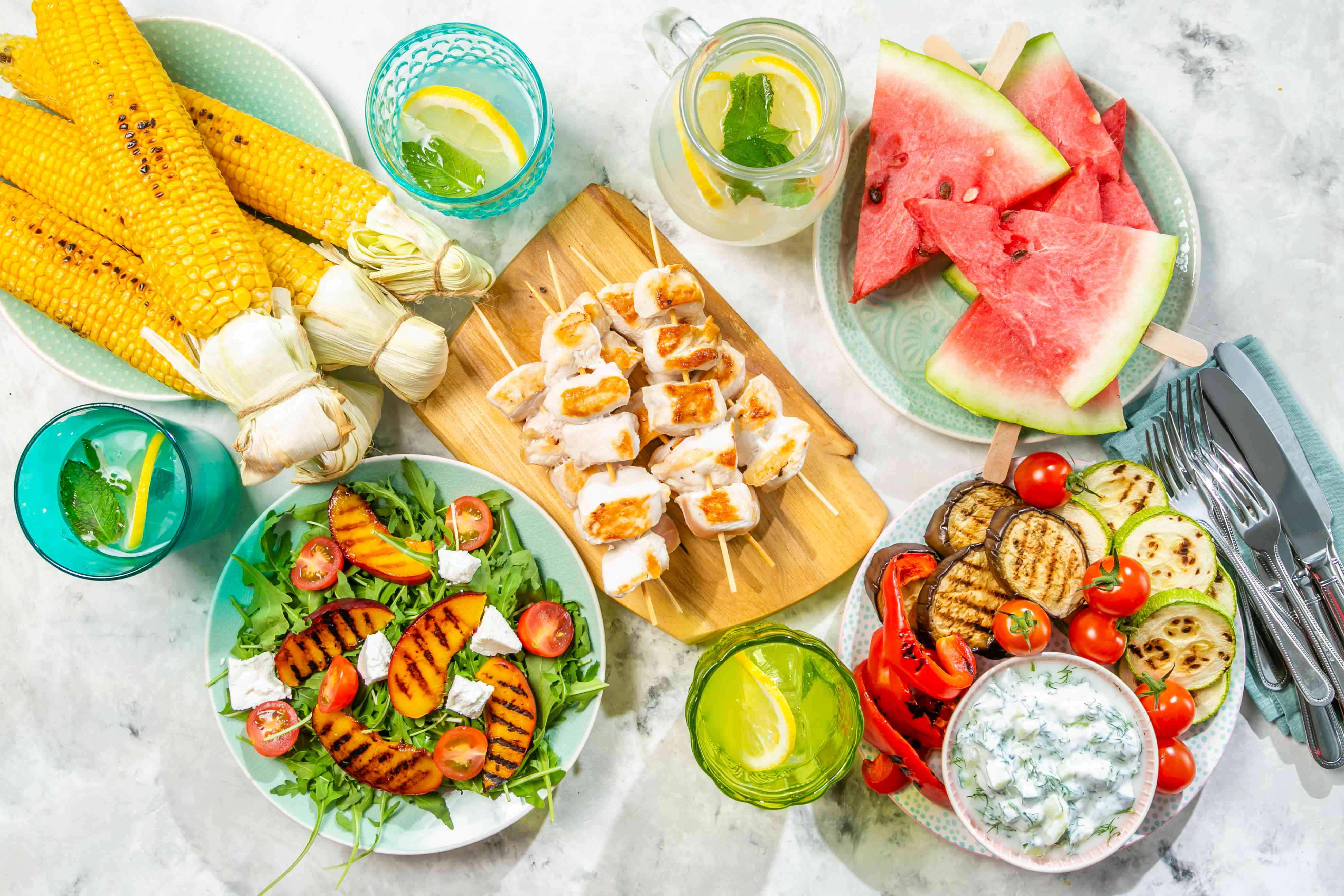Summer bbq party concept - grilled chicken, vegetables, corn, salad, top view