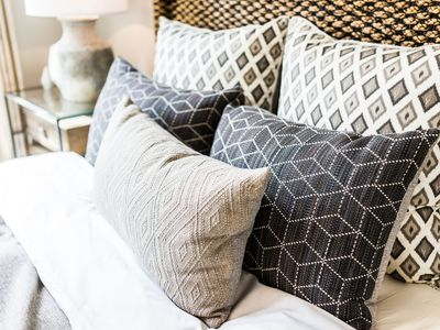 Differently patterned throw pillows