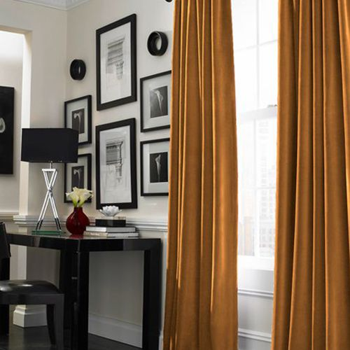 A chic home office with stunning gold curtains