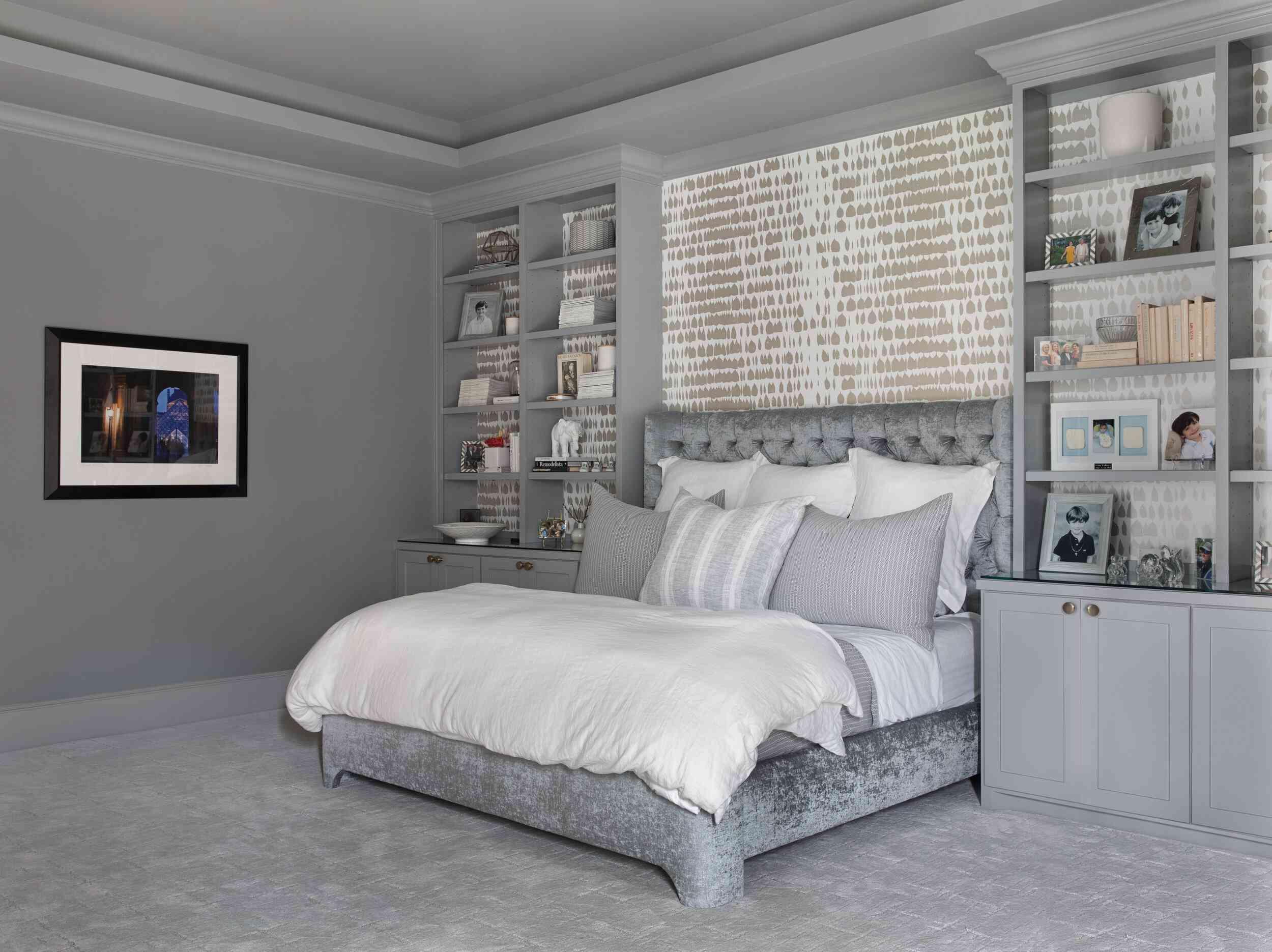 gray monochrome bedroom with built in bookshelves