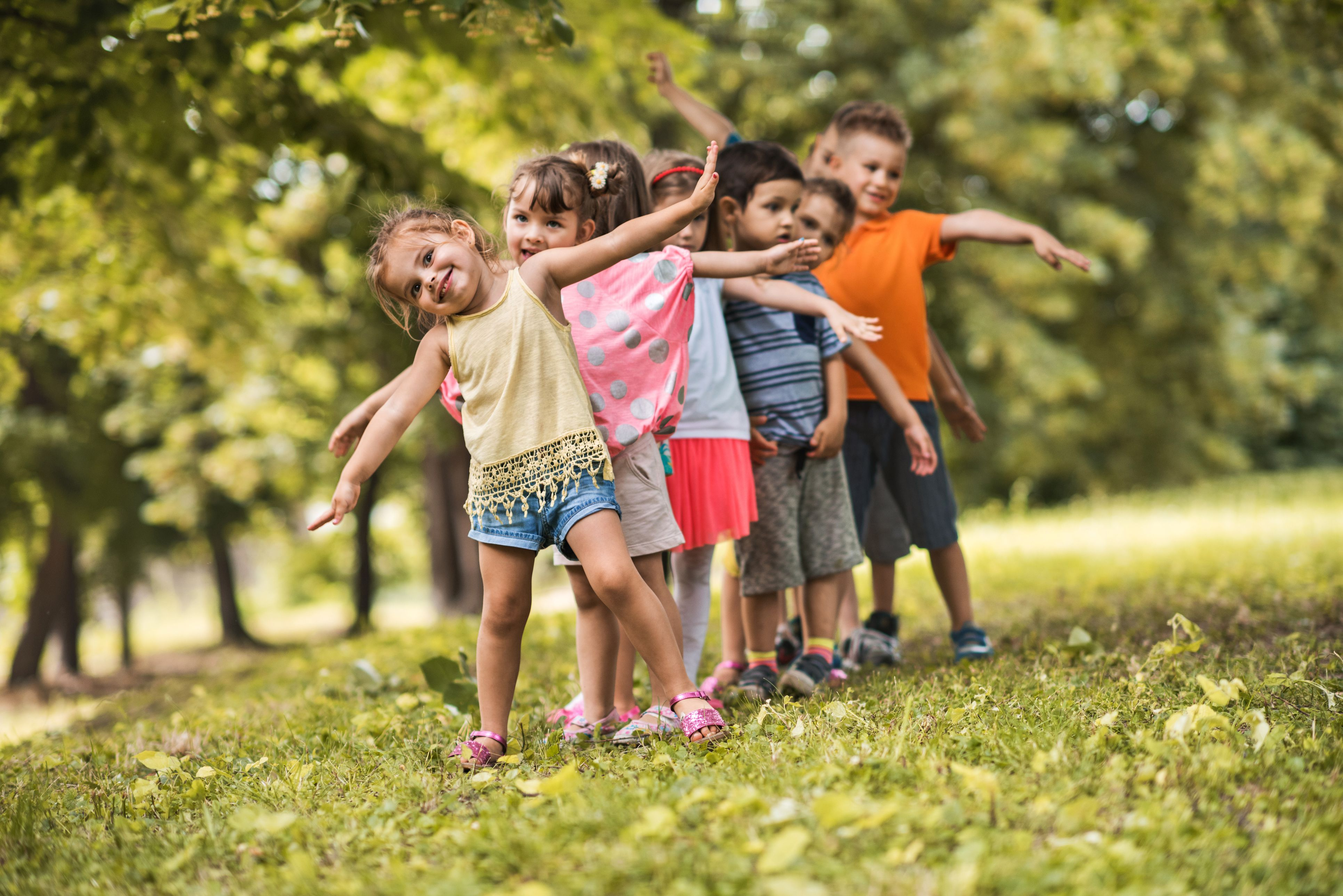 Group of happy kids having fun in the park.