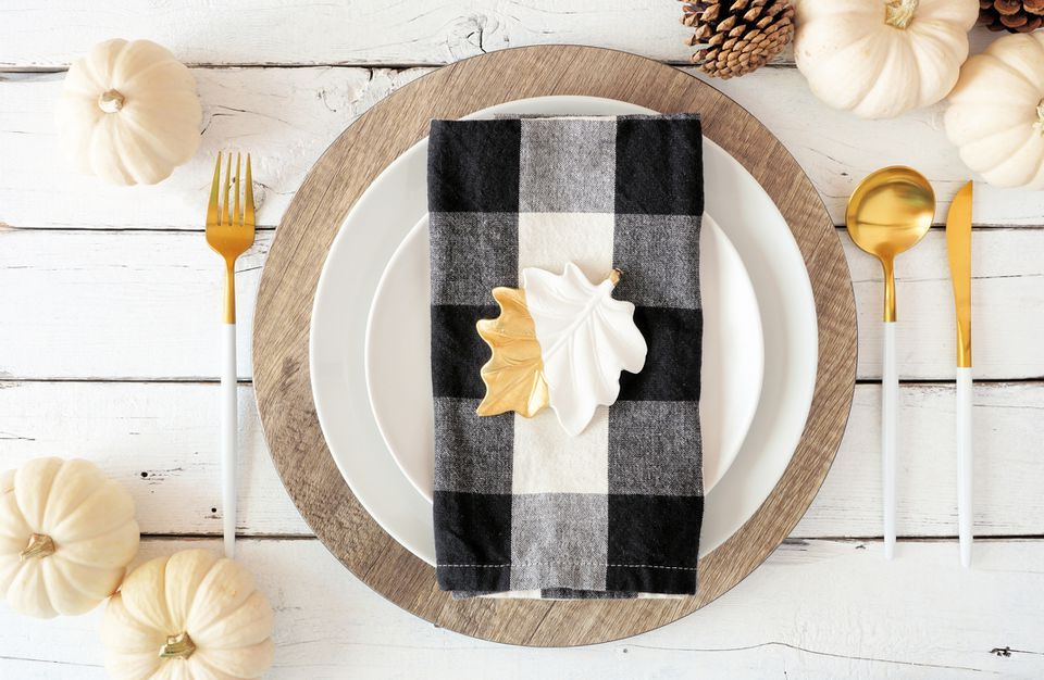 Autumn harvest or thanksgiving dinner table setting. Top view on a white wood background.