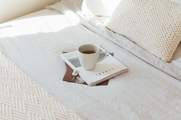 warm bed with a cup of tea