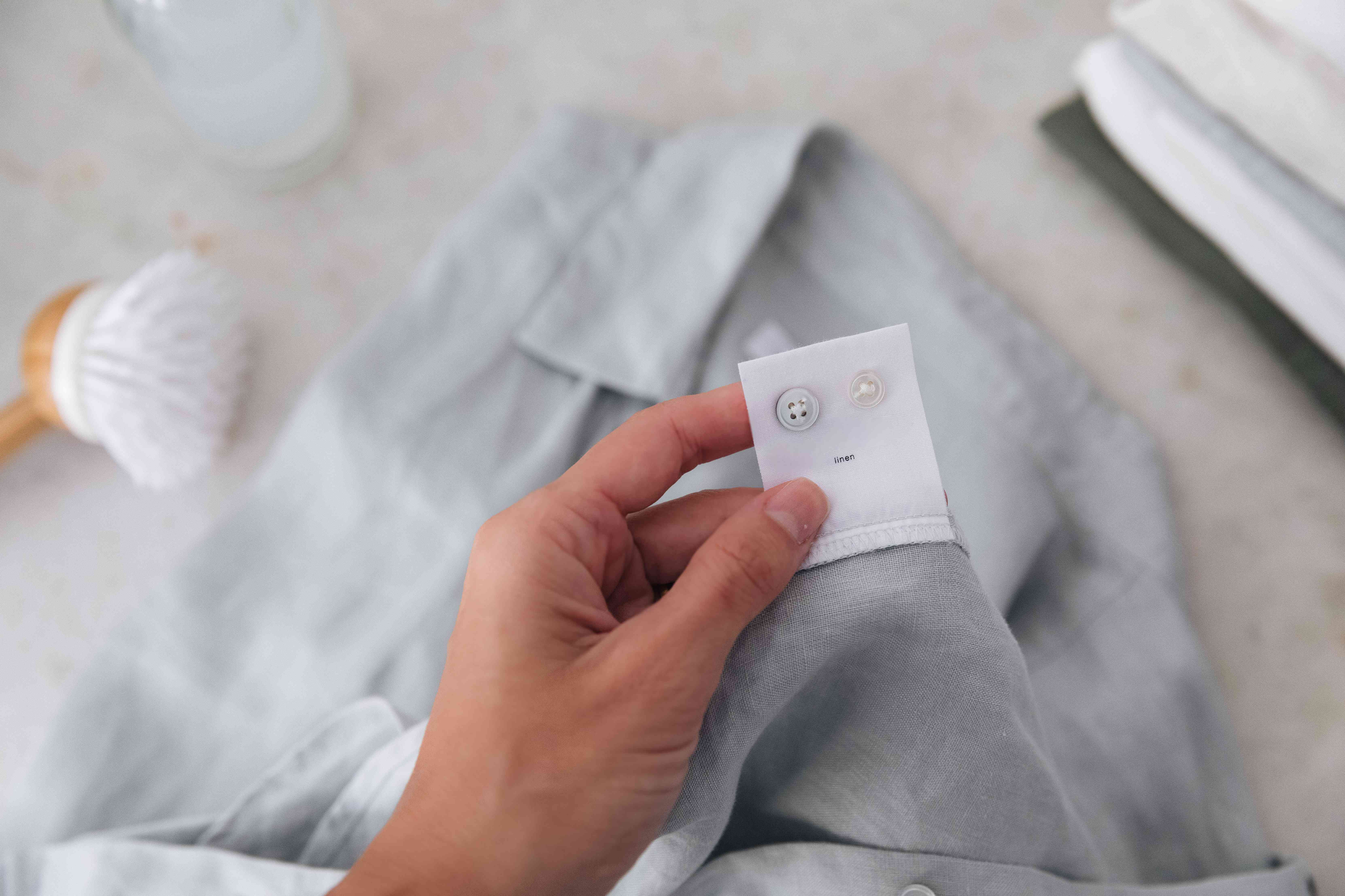 checking the care tag on a linen garment
