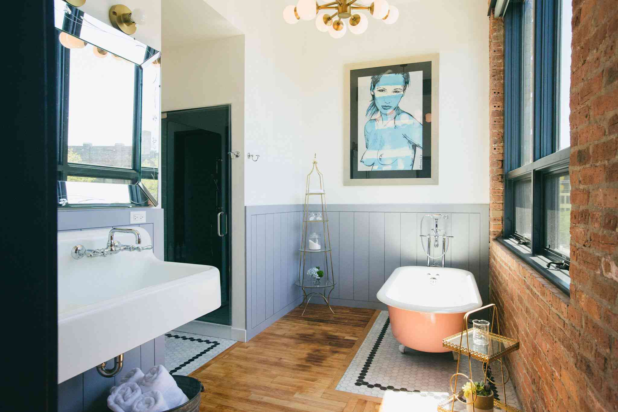Coral clawfoot tub in blue and white bedroom