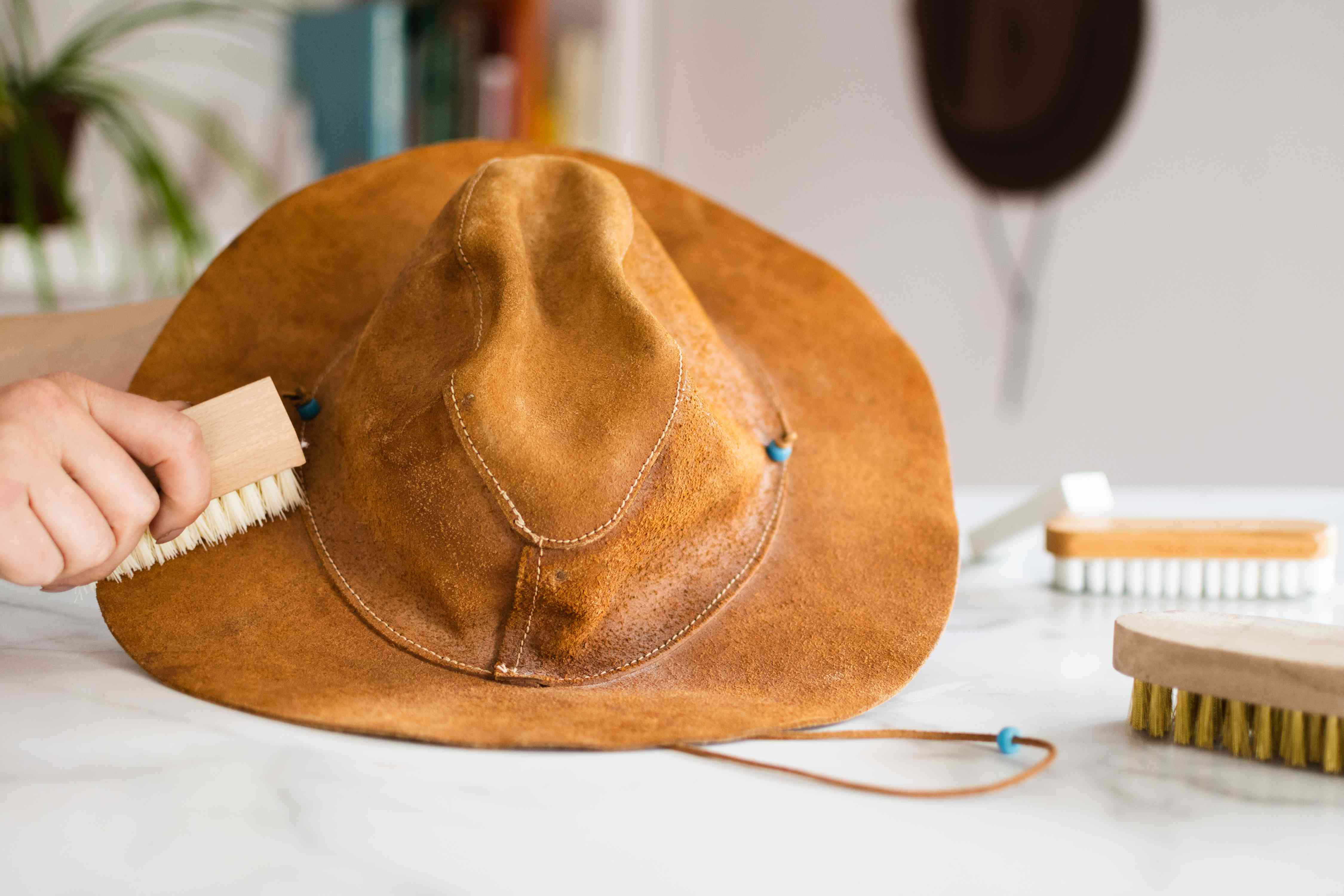 Light brown suede leather hat cleaned with a soft-bristled brush