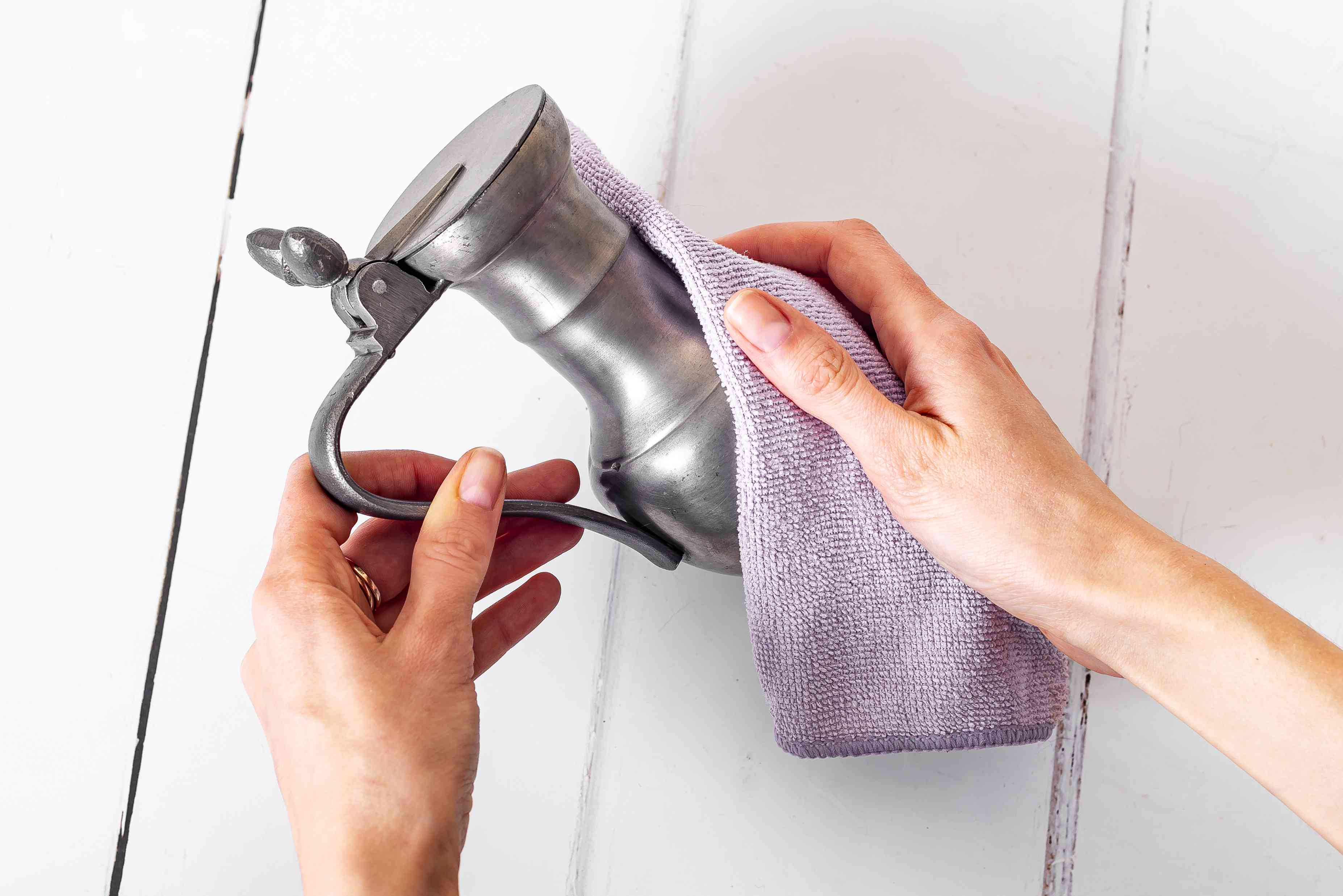 Pewter dispenser dried with purple microfiber cloth
