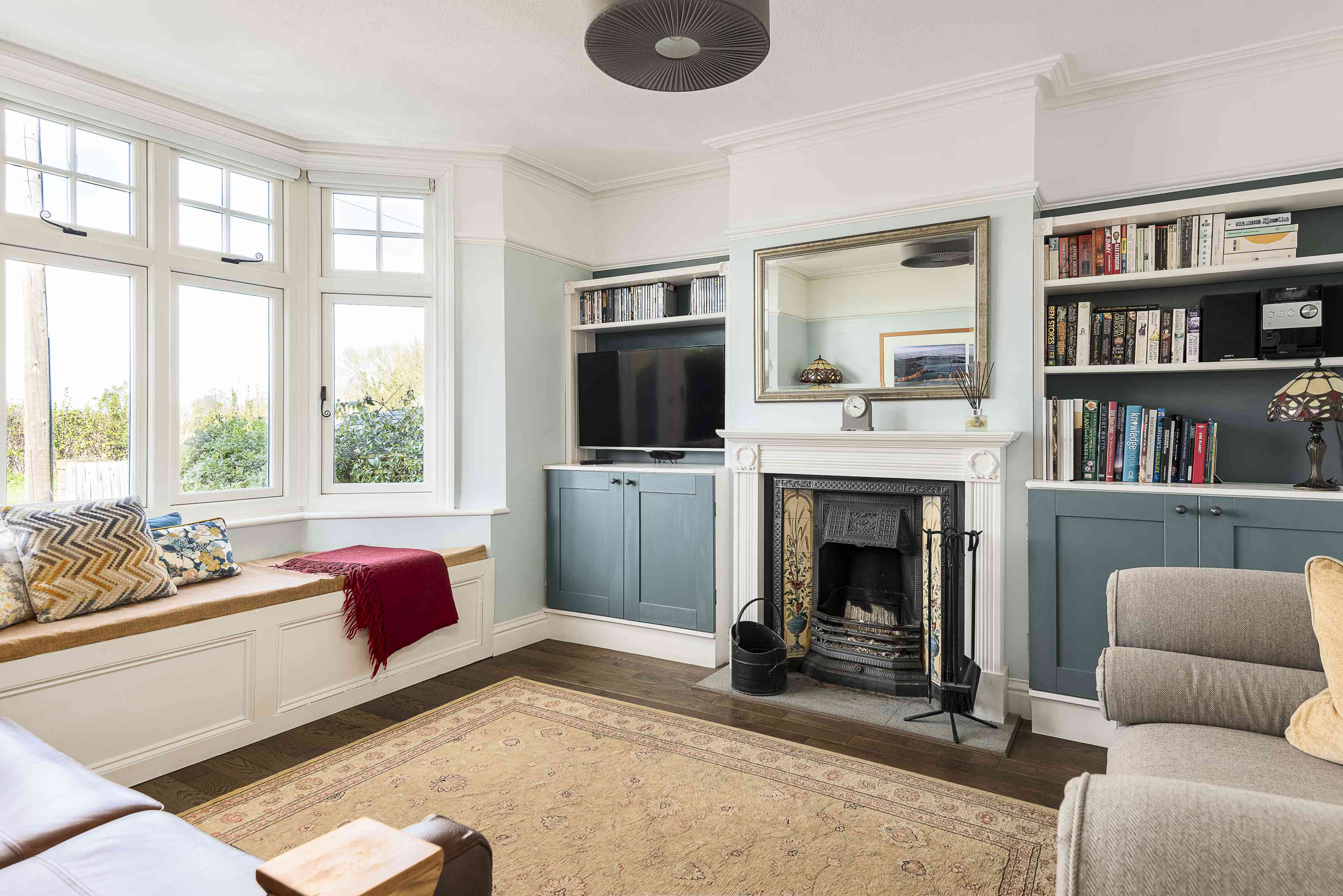 A living room without a coffee table and unstaged