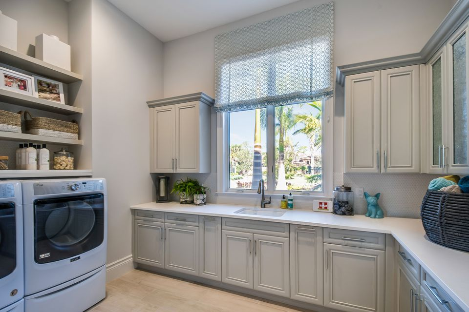 Big laundry room with plenty of cabinets and shelves for all your needs